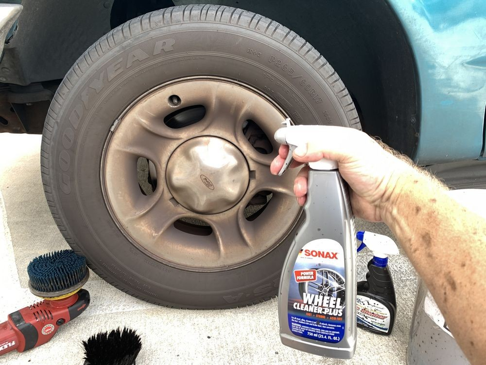 SONAX Wheel Cleaner Plus about to be sprayed on wheel.