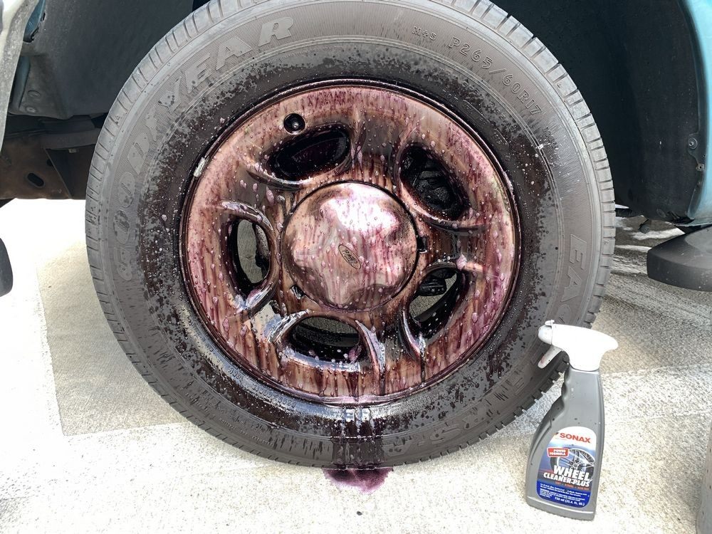 SONAX Wheel Cleaner Plus turns red as it reacts to ferrous material.