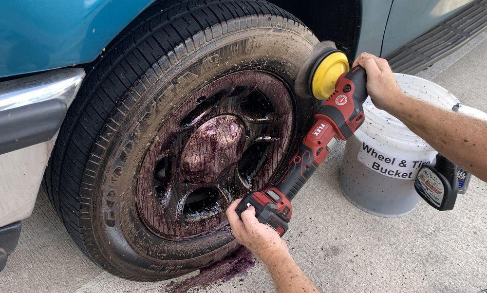 Machine scrubbing the tires while wheels soak.