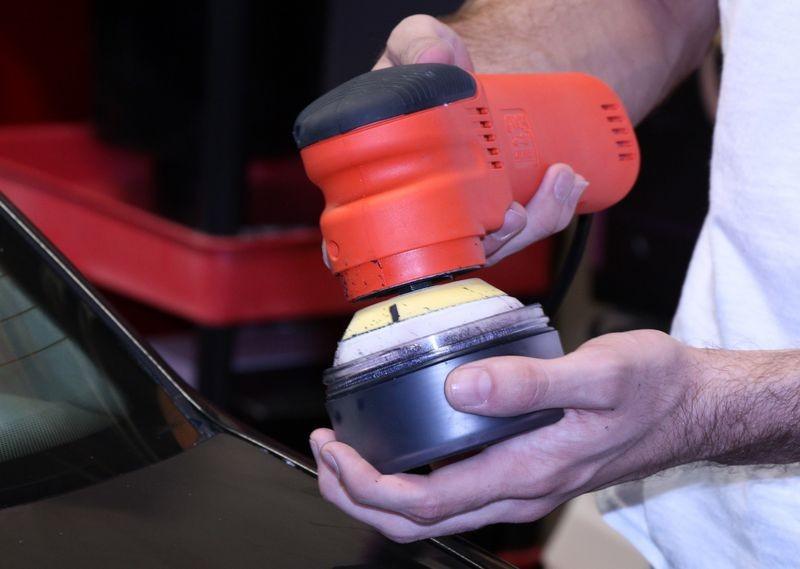 Machine applying wax to car.
