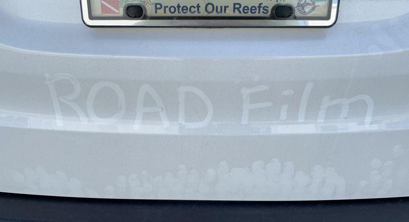 Road Film written on dirty car.