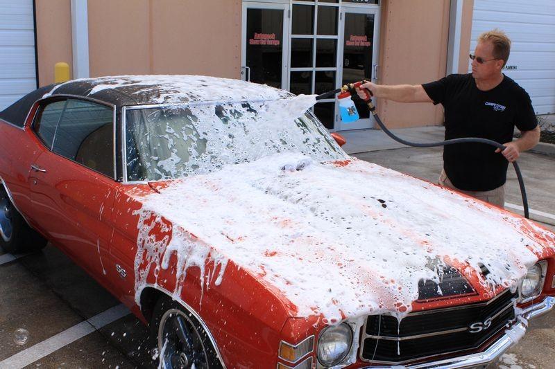 Spraying foam onto 2 door Chevy.