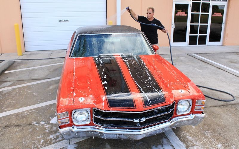 Once you've washed, rinse entire car with water.