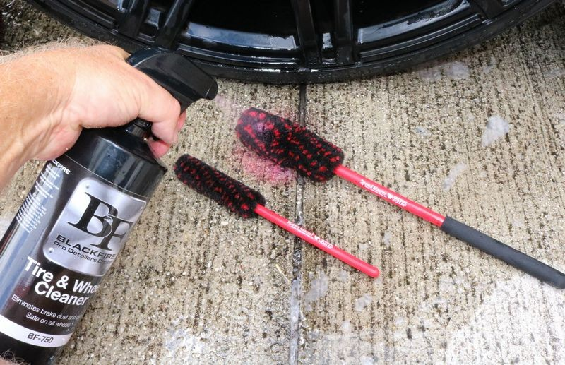 Spray smaller wheel detailing brushes with cleaner to clean hard-to-reach areas.