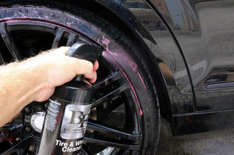 Now spray cleaner onto tire sidewall.