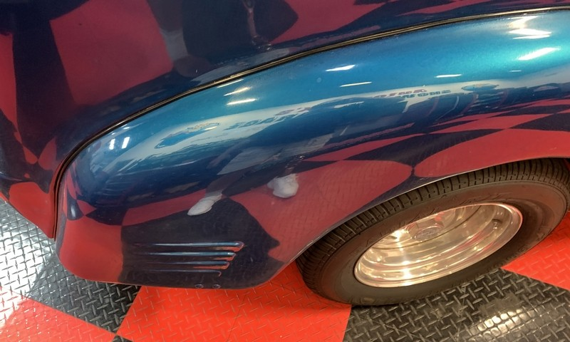 Close up of paint defects on front fender.
