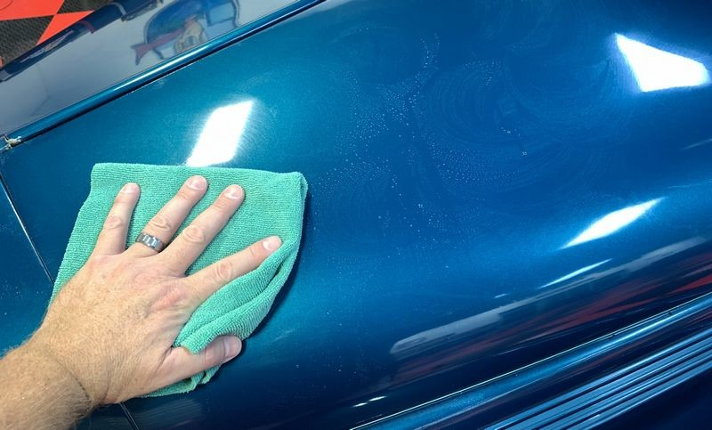 Wiping away paint coating.