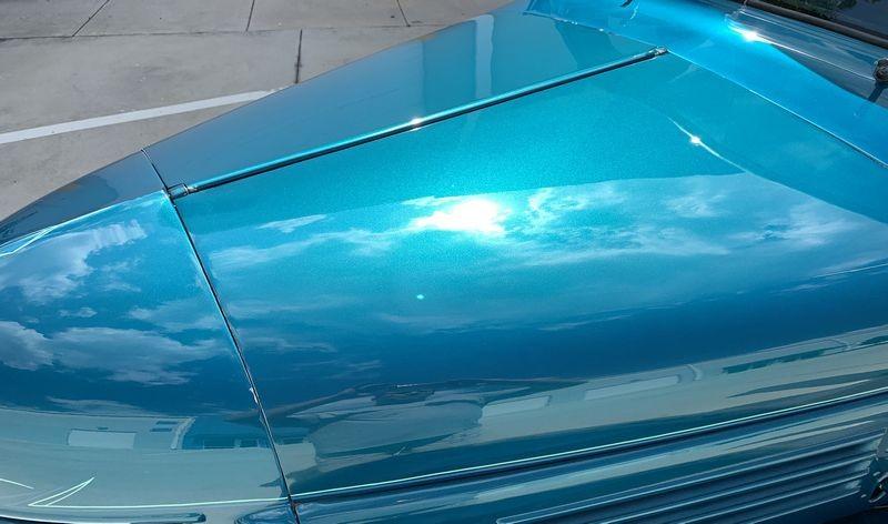 Sunlight reflection shot on hood of finished streetrod.