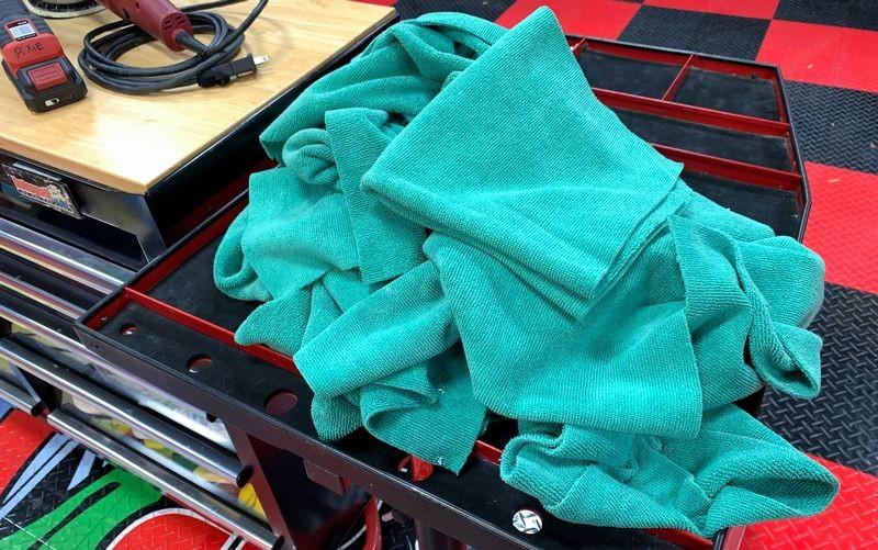 Pile of green microfiber edgeless towels.