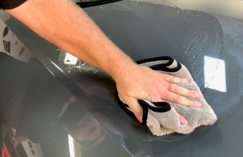 Remove remaining clay lubricant with a clean microfiber towel.