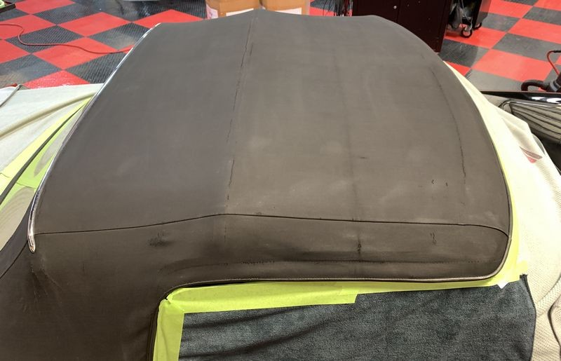Old and faded convertible top before treatment.