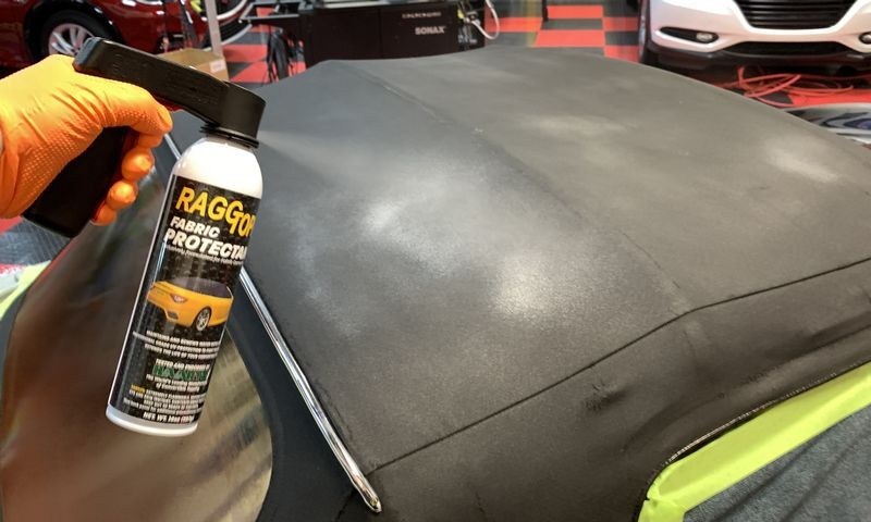 Spraying second can onto convertible top.