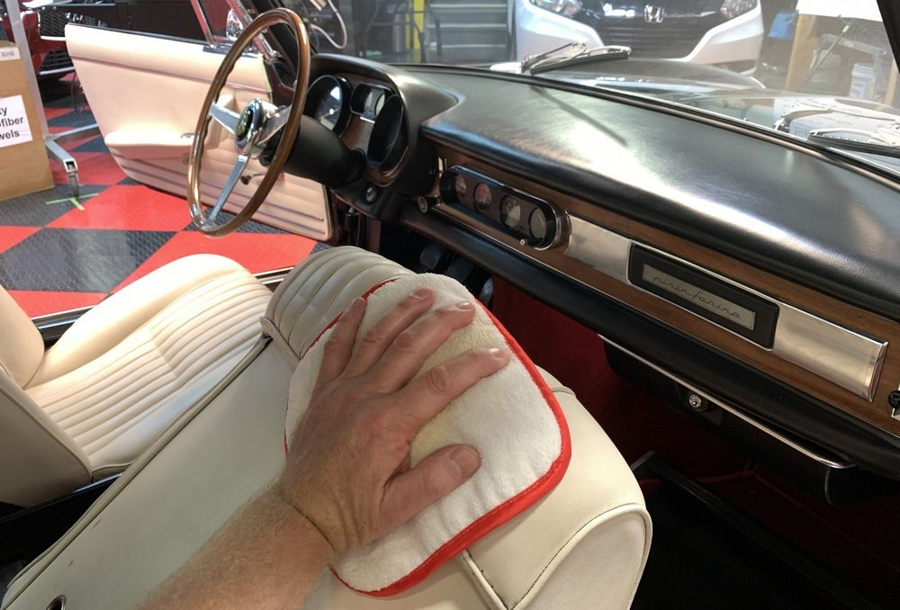 Applying Rejuvenator Oil to leather surfaces.