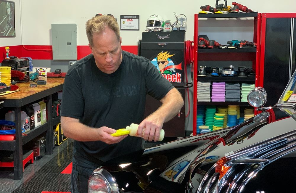 Mike Phillips applying Collinite Wax to foam wax applicator.