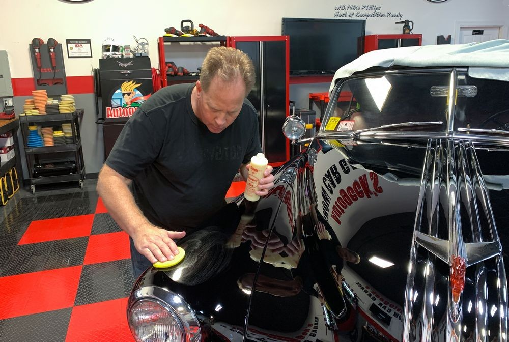 Mike Phillips applying Collinite Wax to car's surface.