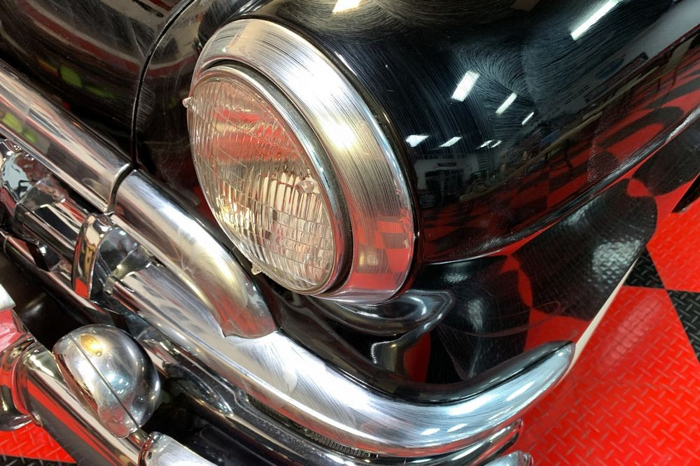 Close up shot of Collinite wax applied to britework on headlights.