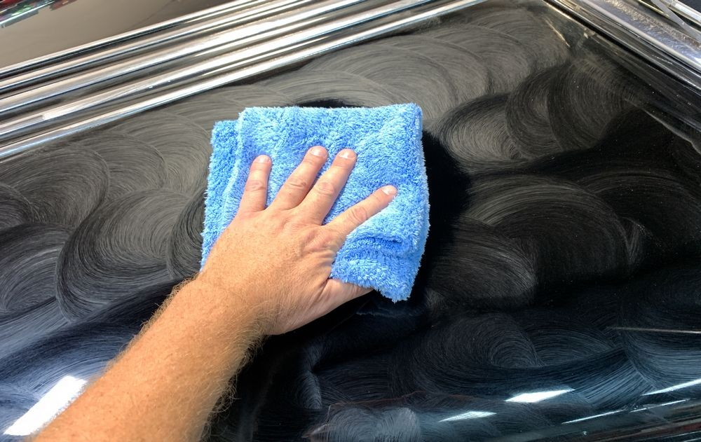 Speed Master Cloud Buffing Towel wiping away dried on Collinite wax.