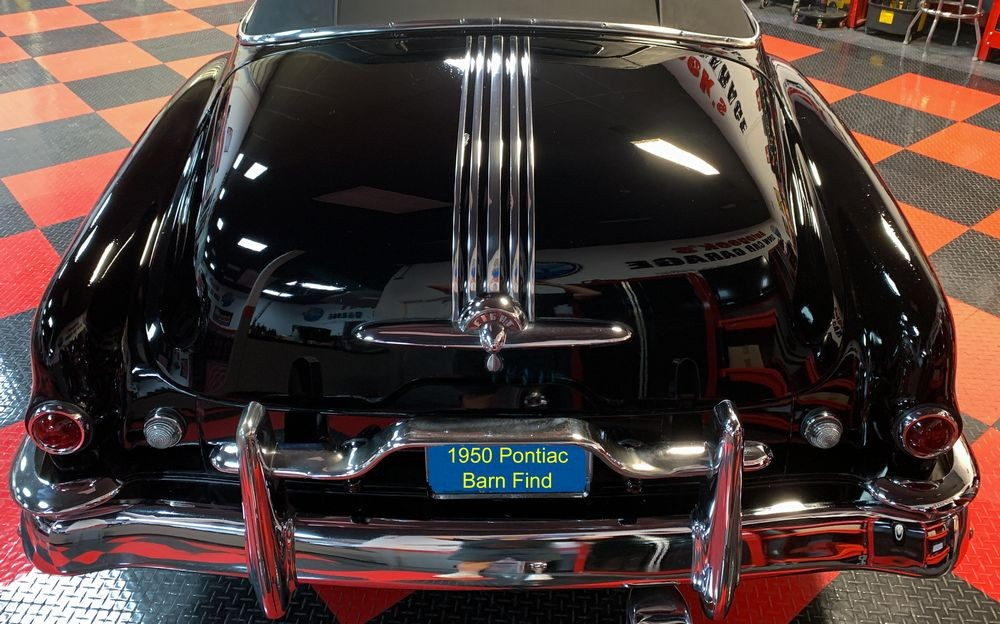 Final results of Collinite Wax applied to black car.