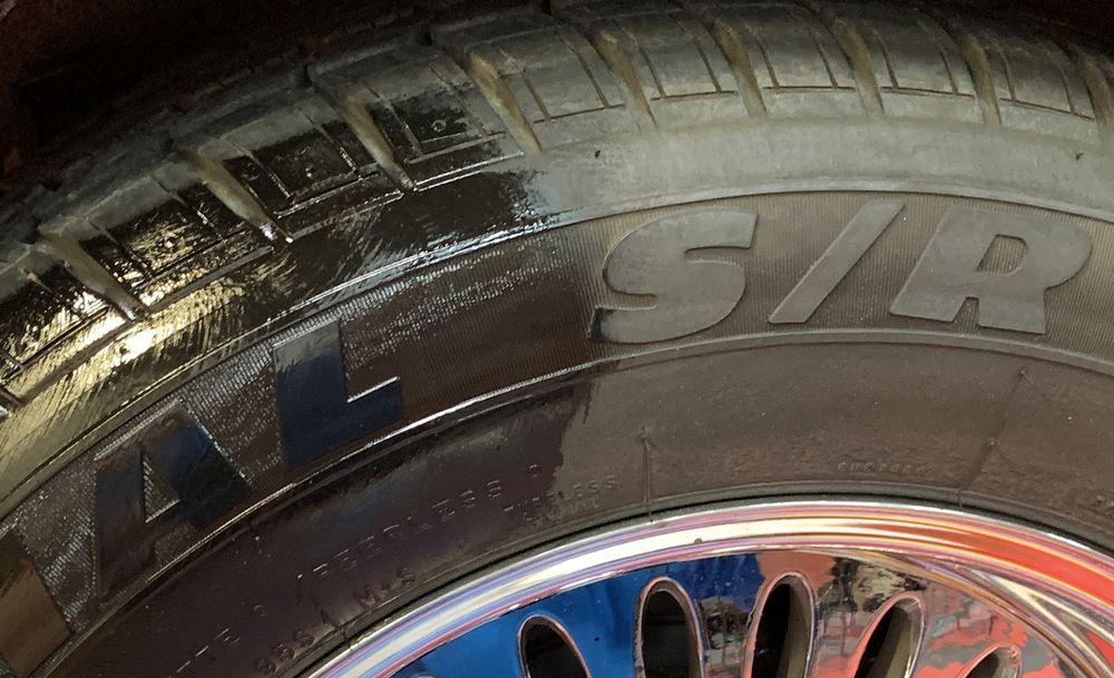 Close up shot of 50/50 GYEON Q2M Tire application.