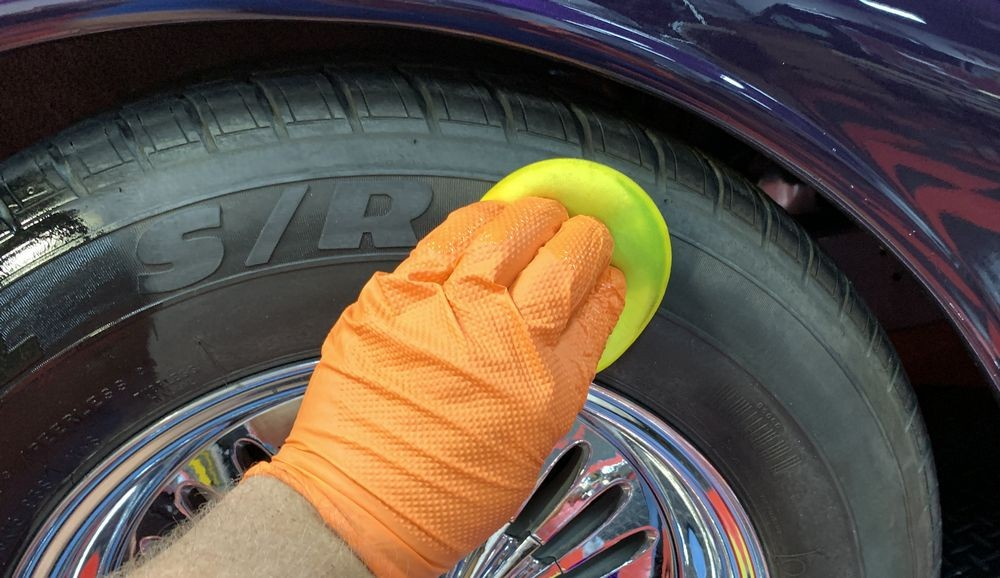 Close up shot of GYEON Q2M Tire being applied by hand.