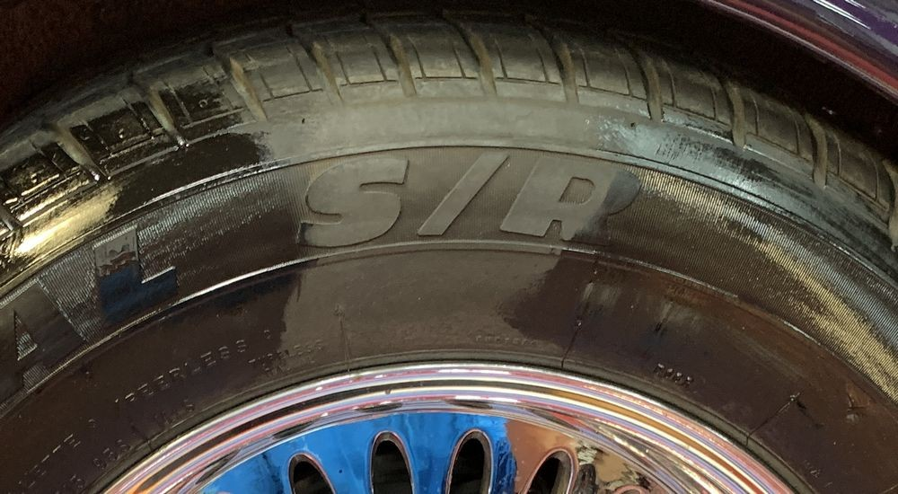Close up 50/50 shot of tire with coating applied.