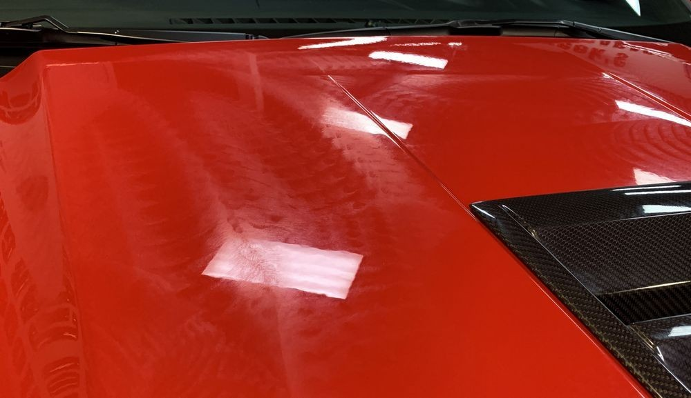 Hood of car after wax is applied.