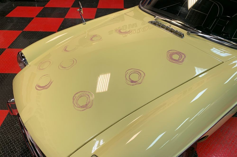 Car with DP Ceramic Paint Sealant schmooshed over paint.