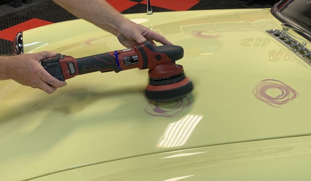 Spreading DP Ceramic Paint Sealant over vehicle.