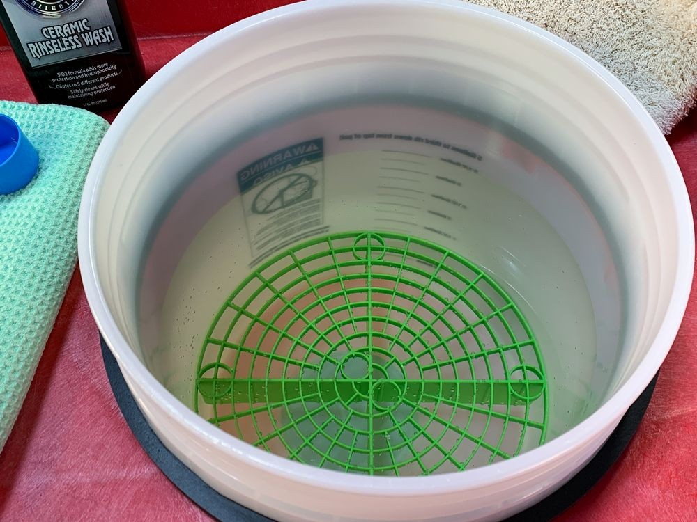 Green Grit Guard in bucket of water.