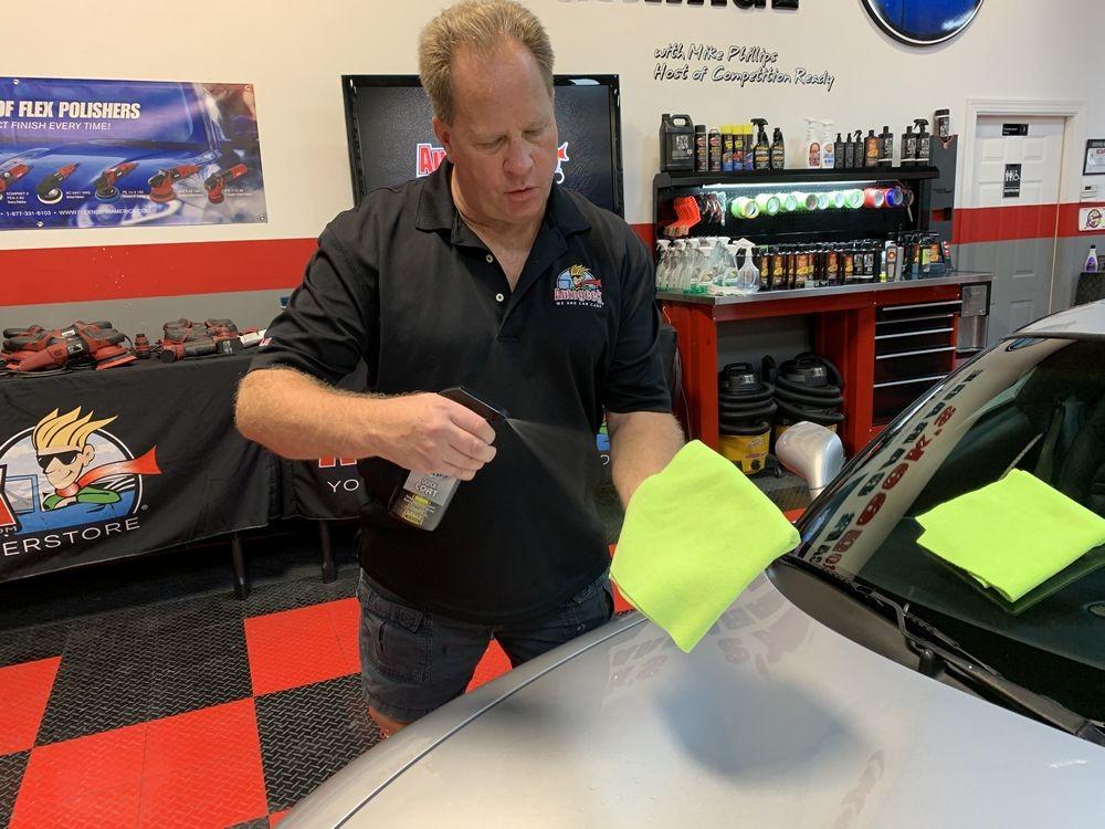 Spraying DP Quick Coat onto microfiber towel.