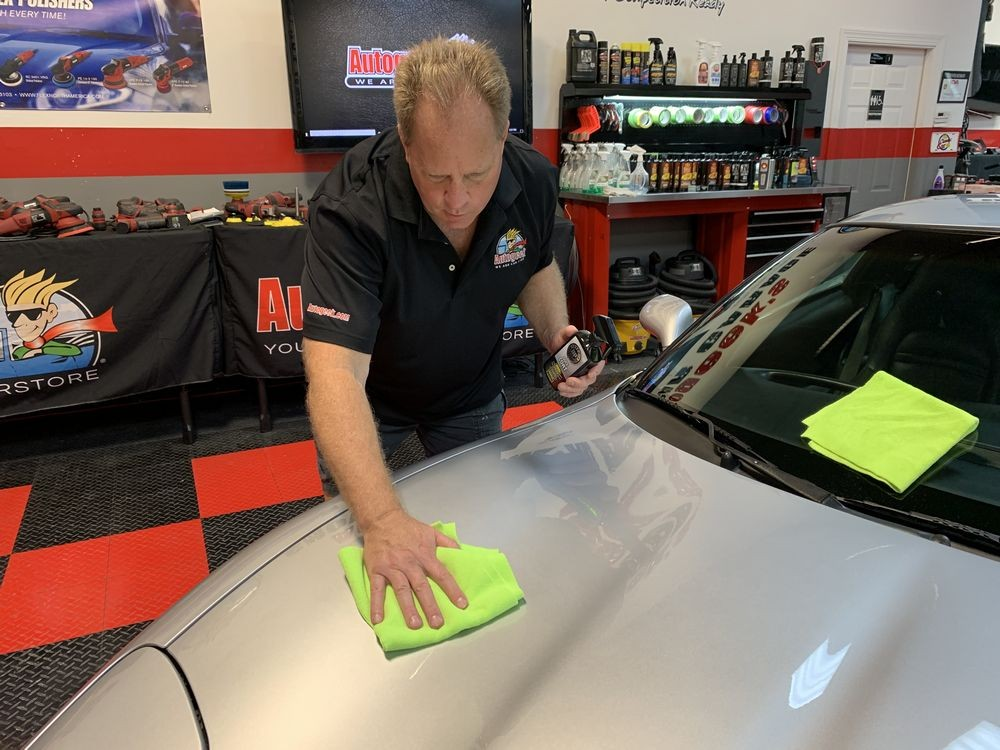 Wiping Corvette with microfiber towel.