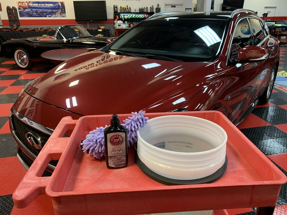 Dirty car with car wash supplies.