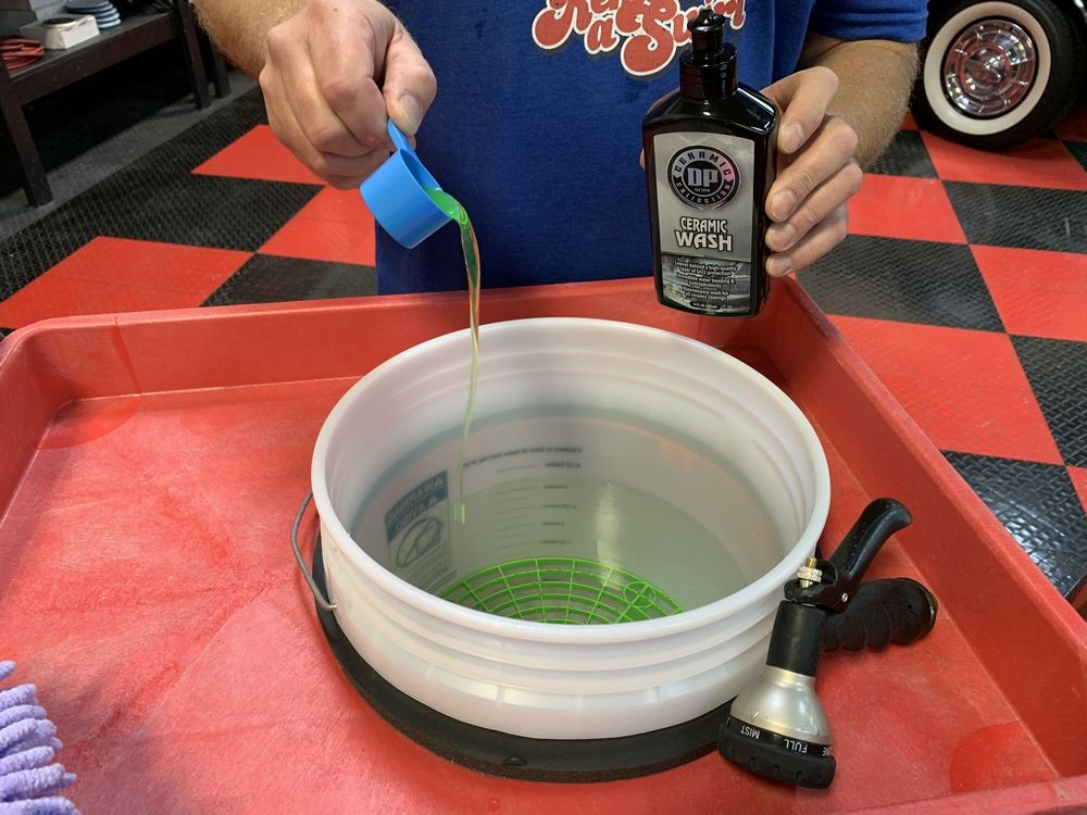 Mixing DP Ceramic Wash into bucket of water