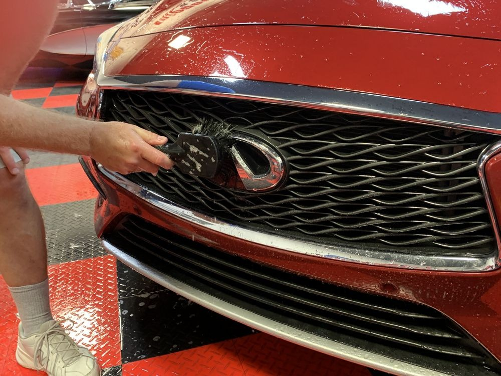 Use a boar's hair brush to clean the front grille.