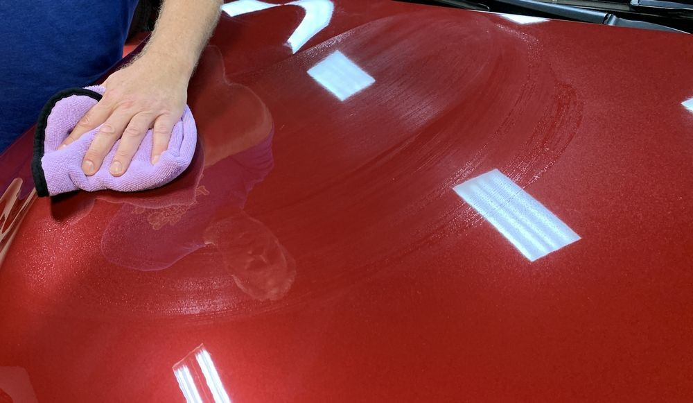 Using a clean, soft microfiber towel, spread the product over the surface.