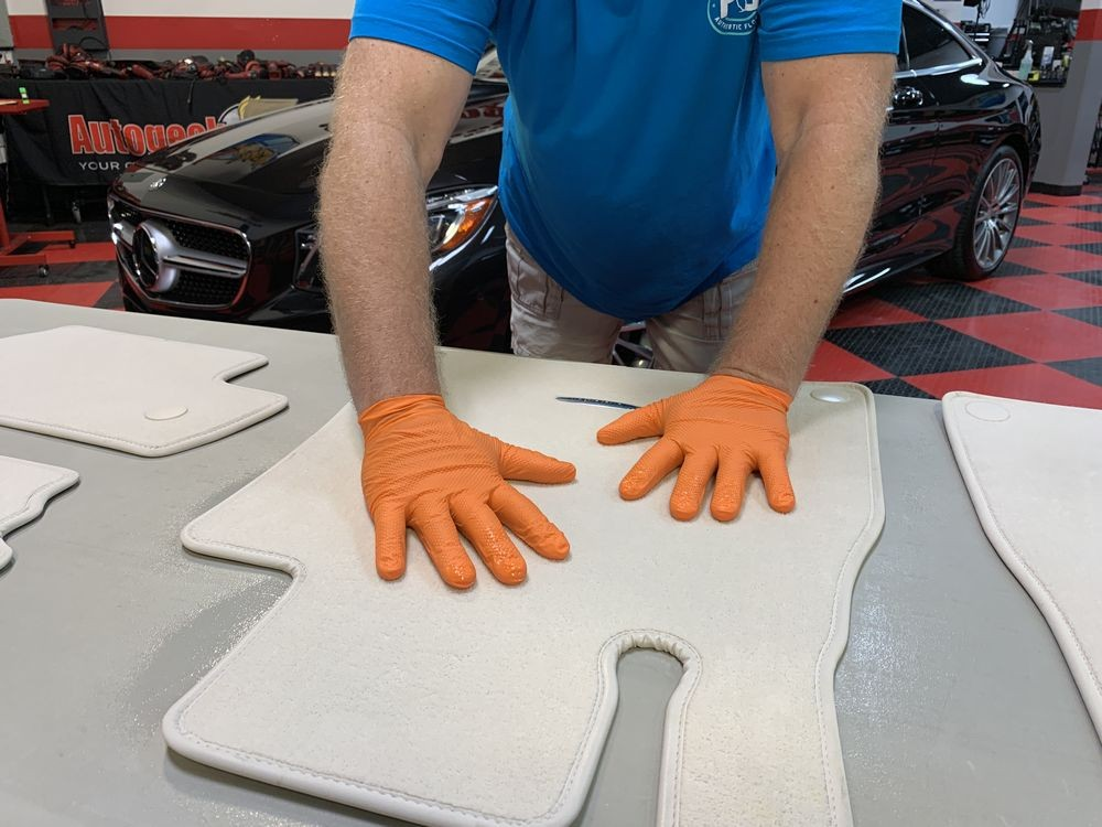 Work 303 Fabric Guard into the carpet fibers with gloved hands.